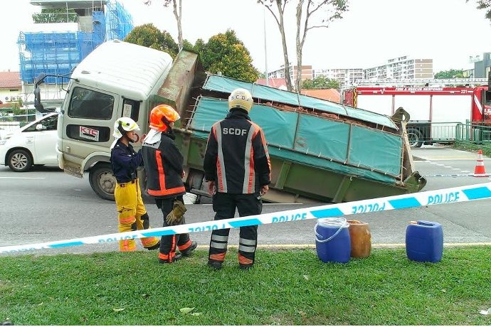 SG: Tipper truck tilts into sinkhole