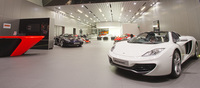 Officially opened in April 2012, the McLaren Singapore showroom stands as the largest McLaren dealership in the Asia Pacific region and is among the largest in the world. Total floor area is 572sqm while the ceiling stretches to 7.5m in height.   From the entrance right through to the McLaren workshop at the back, visitors enjoy an unobstructed view of the entire space. While the current MP4-12C production car takes pride of place on the turntable near the customer lounge area.