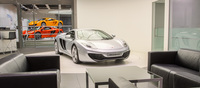 A lone 12C sits on the rotating turntable while the potential new owner observes each curve and line of this purpose-built machine. As described by Frank Stephenson, McLaren's Design Director, the car was designed from day one with constant communication between engineers and designers to come up with a grounded design rather than one where engineers have to work around limits set by the design. Every panel on the 12C serves a purpose to either channel air to the engine's cooling systems or aid in the car's overall aerodynamic efficiency.